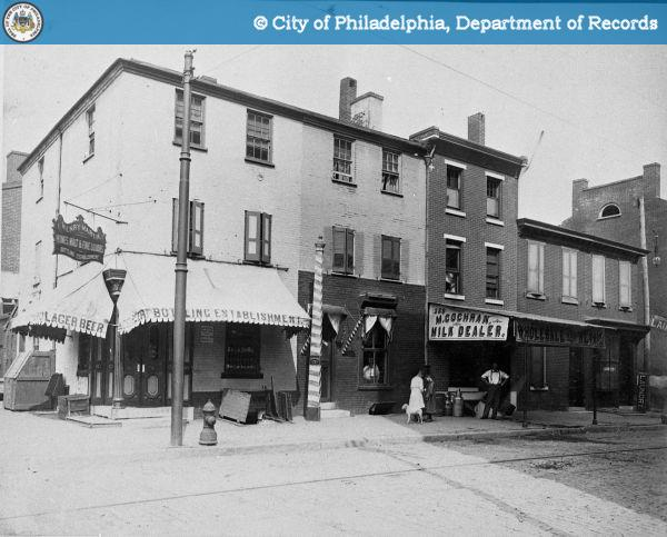 Northeast Corner - 13th and Wood Streets. Henry Martin's Building Establishment and Various Store Fronts.